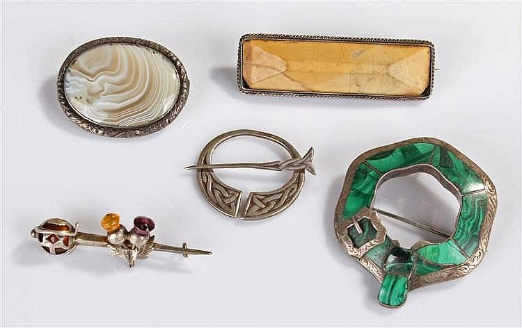 Collection of silver brooches, to include a silver and malachite example, a