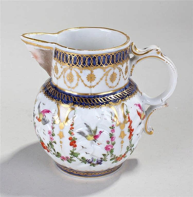 Worcester style Sampson mask jug, the polychrome decorated jug with mask ab