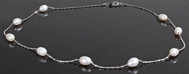 18 carat white gold pearl set necklace, the bead necklace strung with nine
