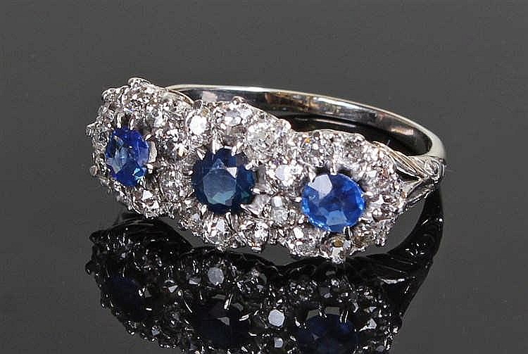 Sapphire and diamond set white gold ring, set with three sapphires surround