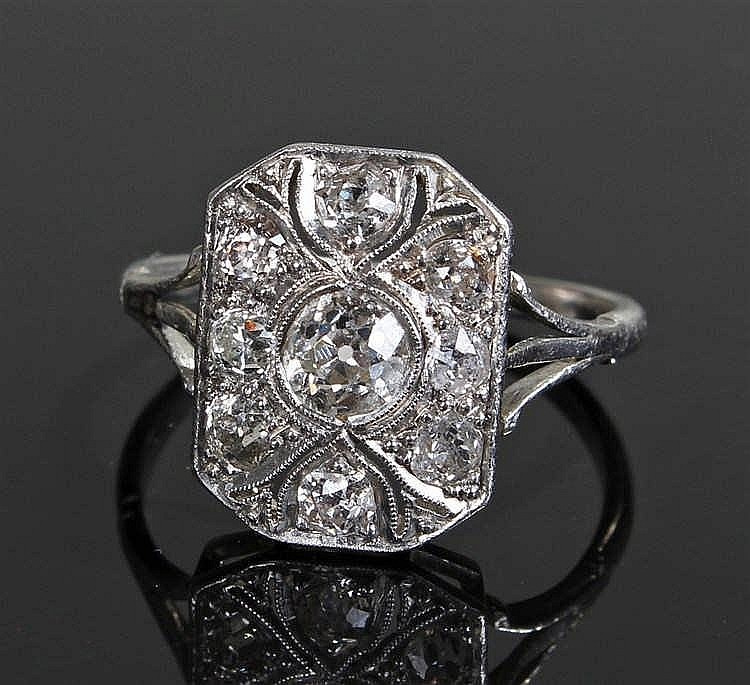 Art Deco diamond and platinum ring, the ring set with 9 diamonds, the centr