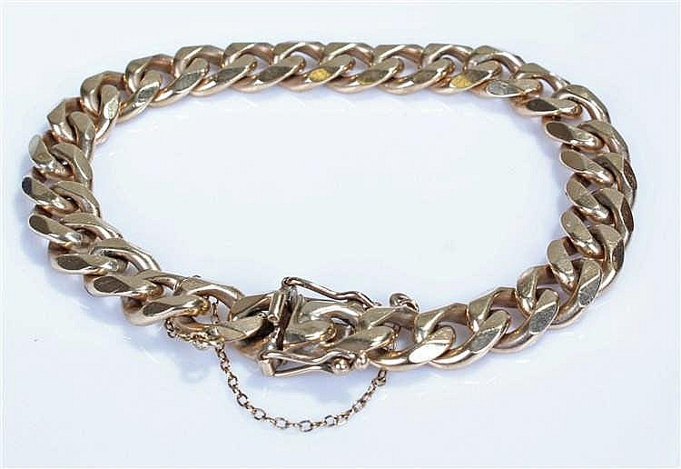 Heavy 9 carat gold curb link bracelet, the links of flattened form, approxi