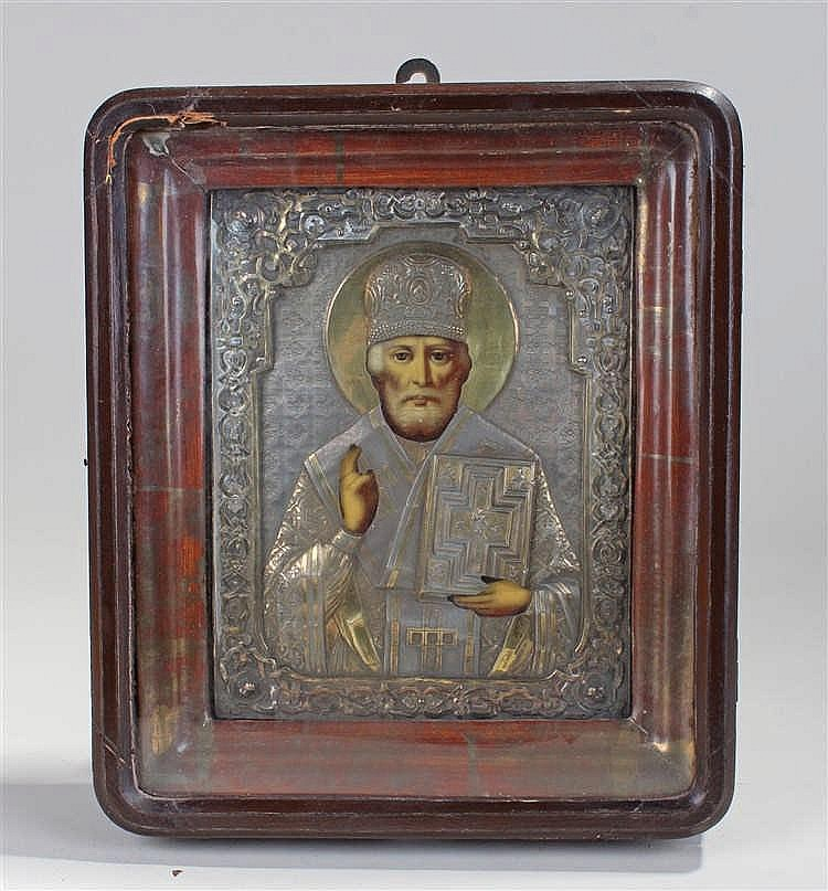 Russian icon, the icon set in gilt and silvered metal with a painted image
