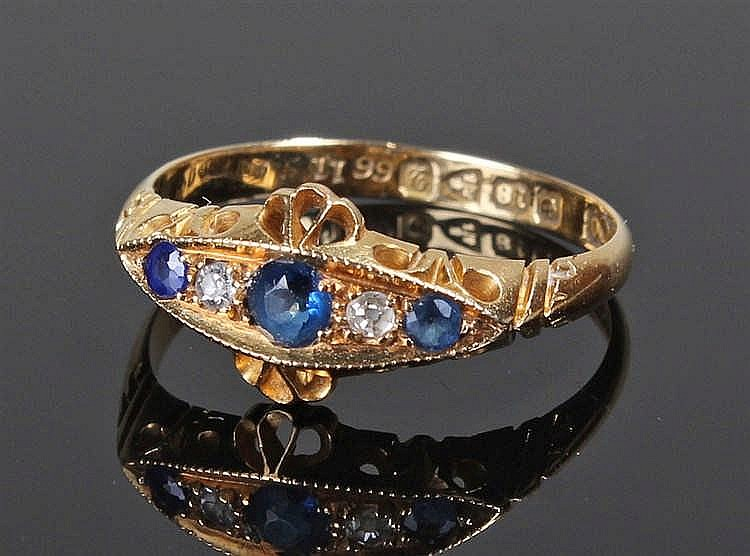 18 carat gold, diamond and sapphire ring, the three sapphires with the cent