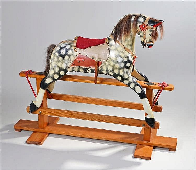Early 20th Century rocking horse, with white spots on black, 115cm long