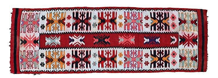 Persian runner, with a central red panel and outer cream field with red bor
