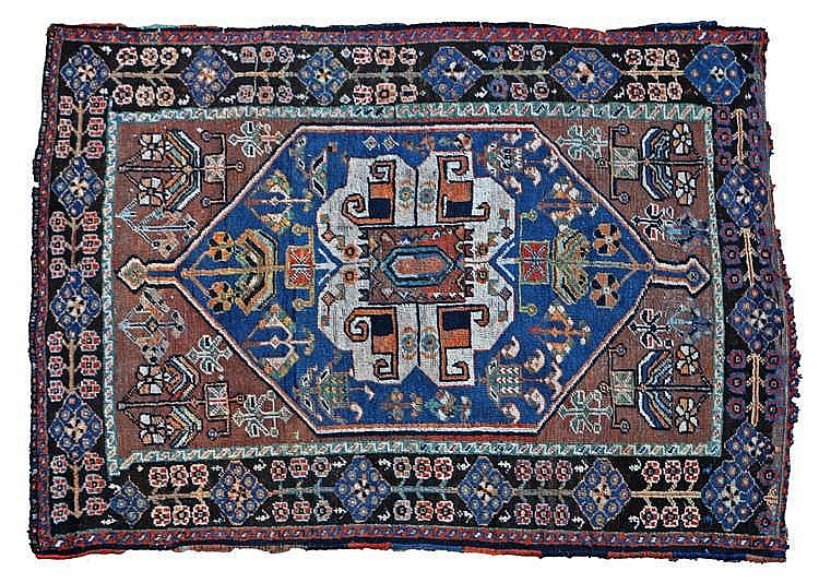 North Persian rug, the central field decorated with geometric designs and s