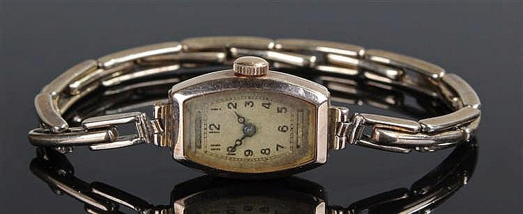 9 carat ladies gold wristwatch, the shaped rectangular dial with Arabic hou