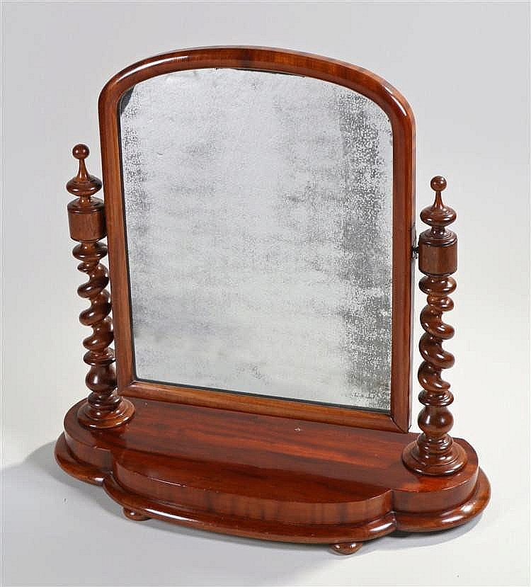 Victorian mahogany toilet mirror, the arched top plate on barley twist supp