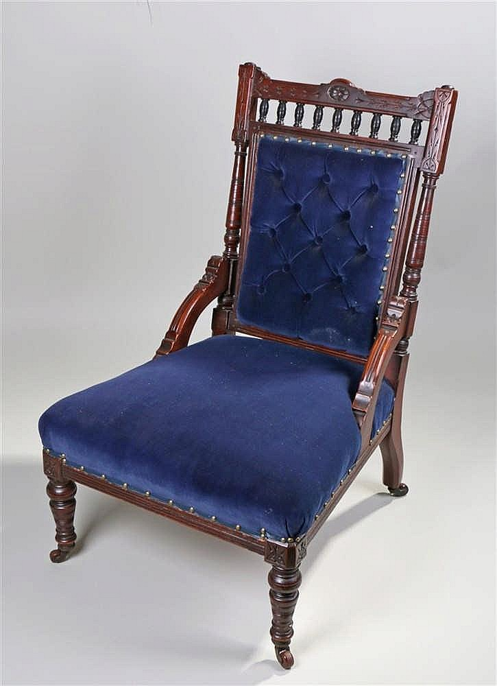 Victorian nursing chair, the carved top rail above a finial gallery and a b
