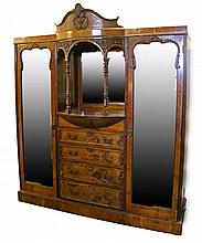 Maple & Co Edwardian walnut and oak wardrobe, the central section with a mi