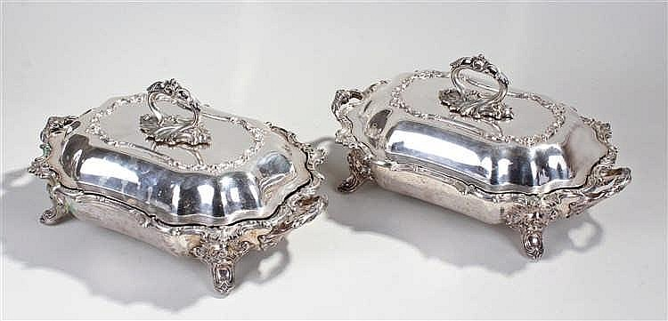 Two silver plated entree dishes, with hot water reservoir, in the recocco s