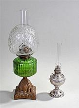 The Tiny Juno USA silver plated oil lamp, together with a frosted glass sha