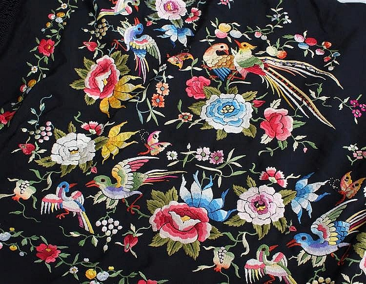 An embroidered shawl, the black ground with brightly embroidered bright bir