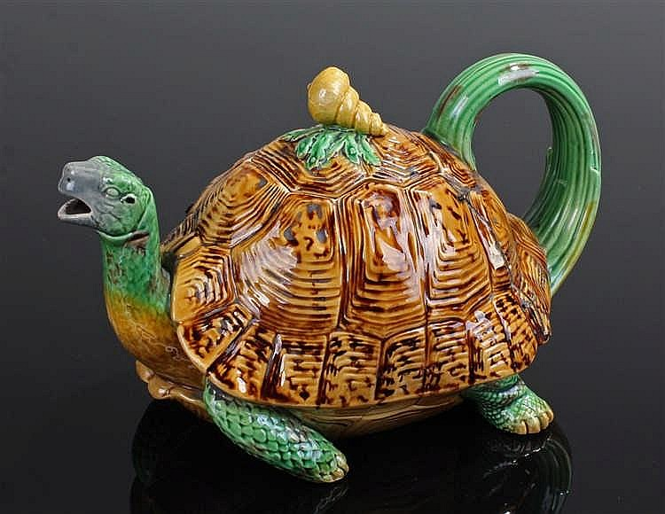 Extremely rare Mintons majolica teapot and cover, modelled naturalistically