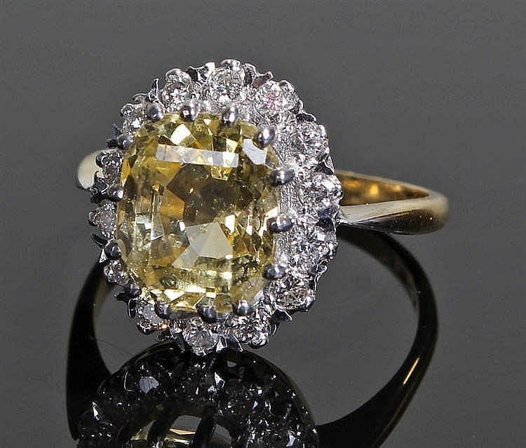 Yellow sapphire and diamond ring, the yellow sapphire at 5.40 carat surroun