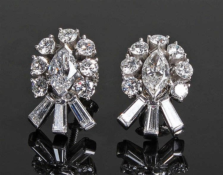 Fine pair of diamond set Tiffany earrings, the marquise diamond middle surr