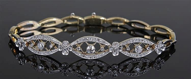 White and yellow gold diamond set bracelet, with three elliptical sections