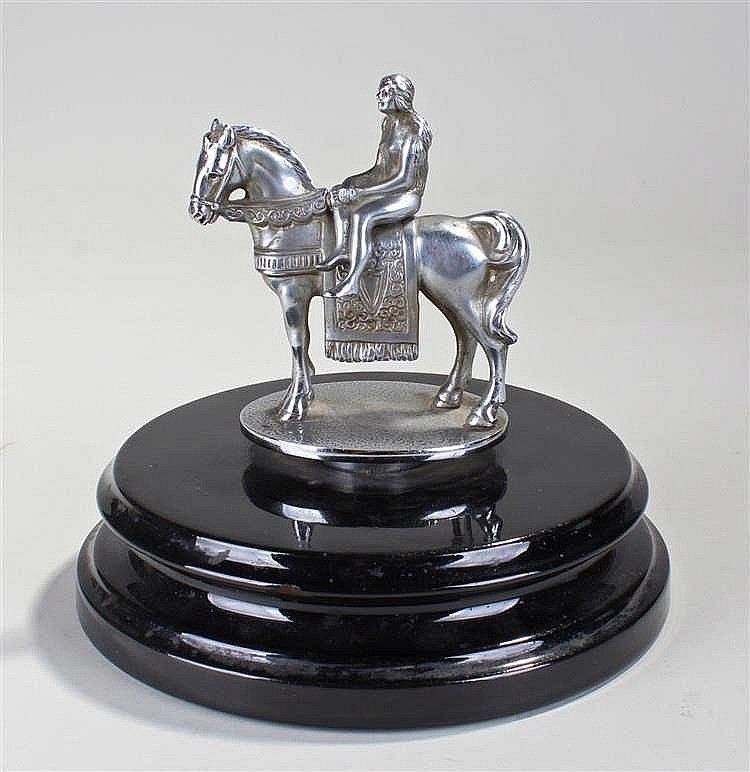 Chrome car mascot by Desmo, of Lady Godiva upon a horse, raised on a circul