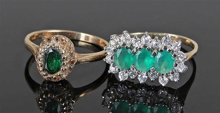 Two 9 carat gold rings, with green stones and cubic zircoina, ring sizes N