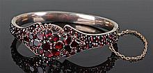 Victorian garnet set yellow metal bracelet, set with 142 garnets of differe