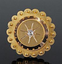 Victorian yellow metal and diamond set mourning brooch, the shaped circular