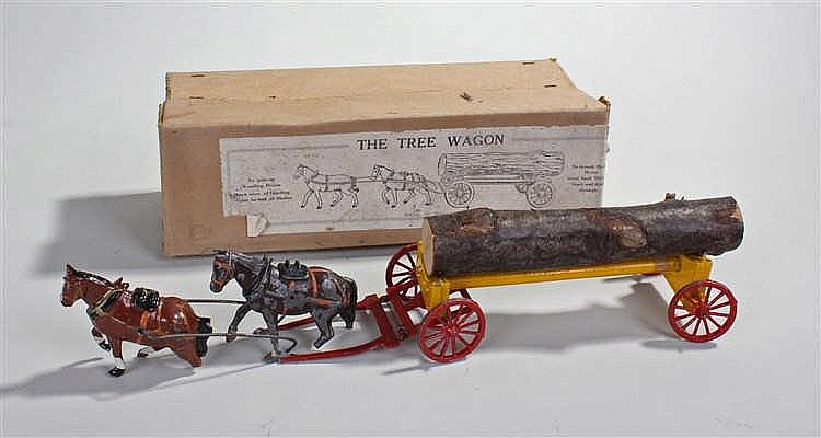 Hollow cast Tree Wagon, the box marked Made in England, the yellow wagon wi
