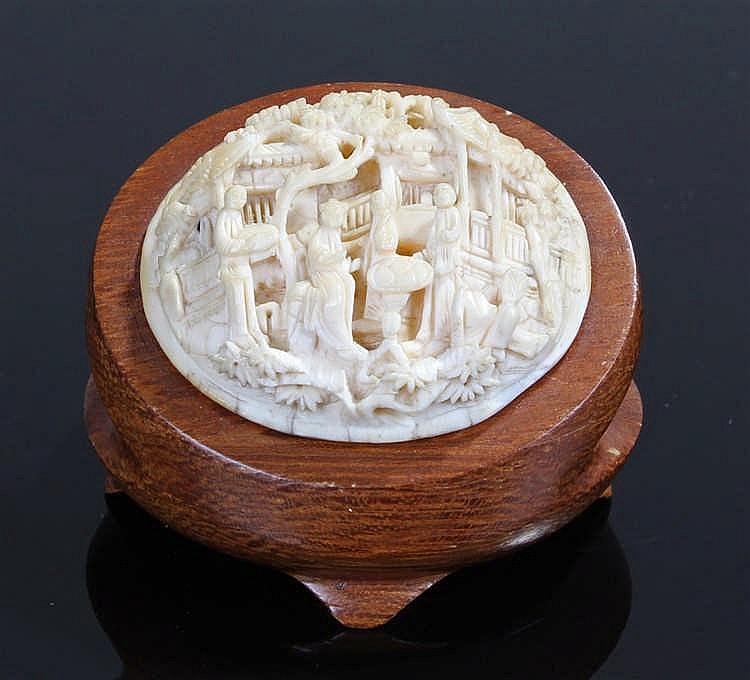 Late 19th Century Canton ivory plaque, intricately carved with figures and