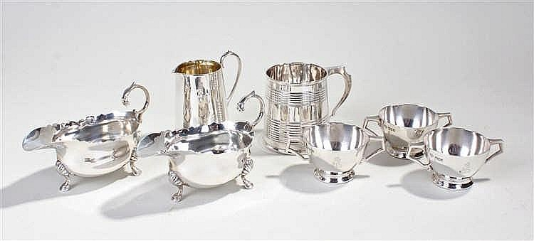 Collection of silver hollo ware, including two sauce boats, a cream jug, a