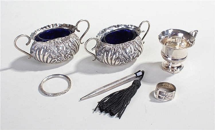 Collection of silver items, to include two silver salts with blue glass lin