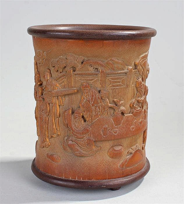 Imperial chinese brush pot carved with figures by a table w
