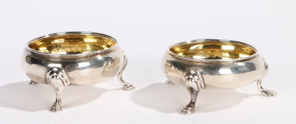 Pair of George III silver salts, London 1762, maker John Muns, of cauldron form with gilt interiors,