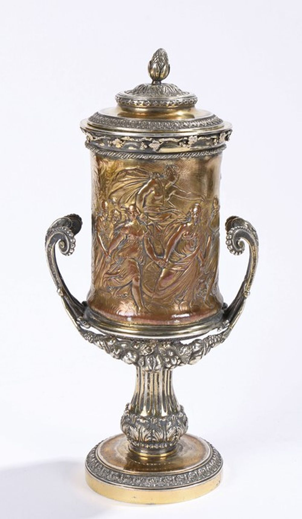 19th Century gilt white metal cup and cover, the lid with pineapple finial and acanthus leaf decorat