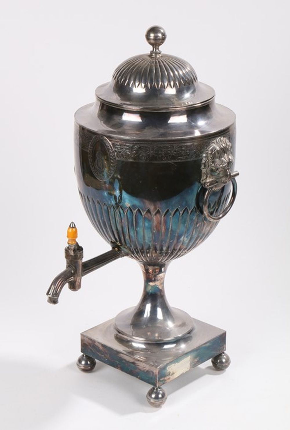 Late 18th Century silver plated hot water urn, the gadrooned domed cover above a scroll and foliate
