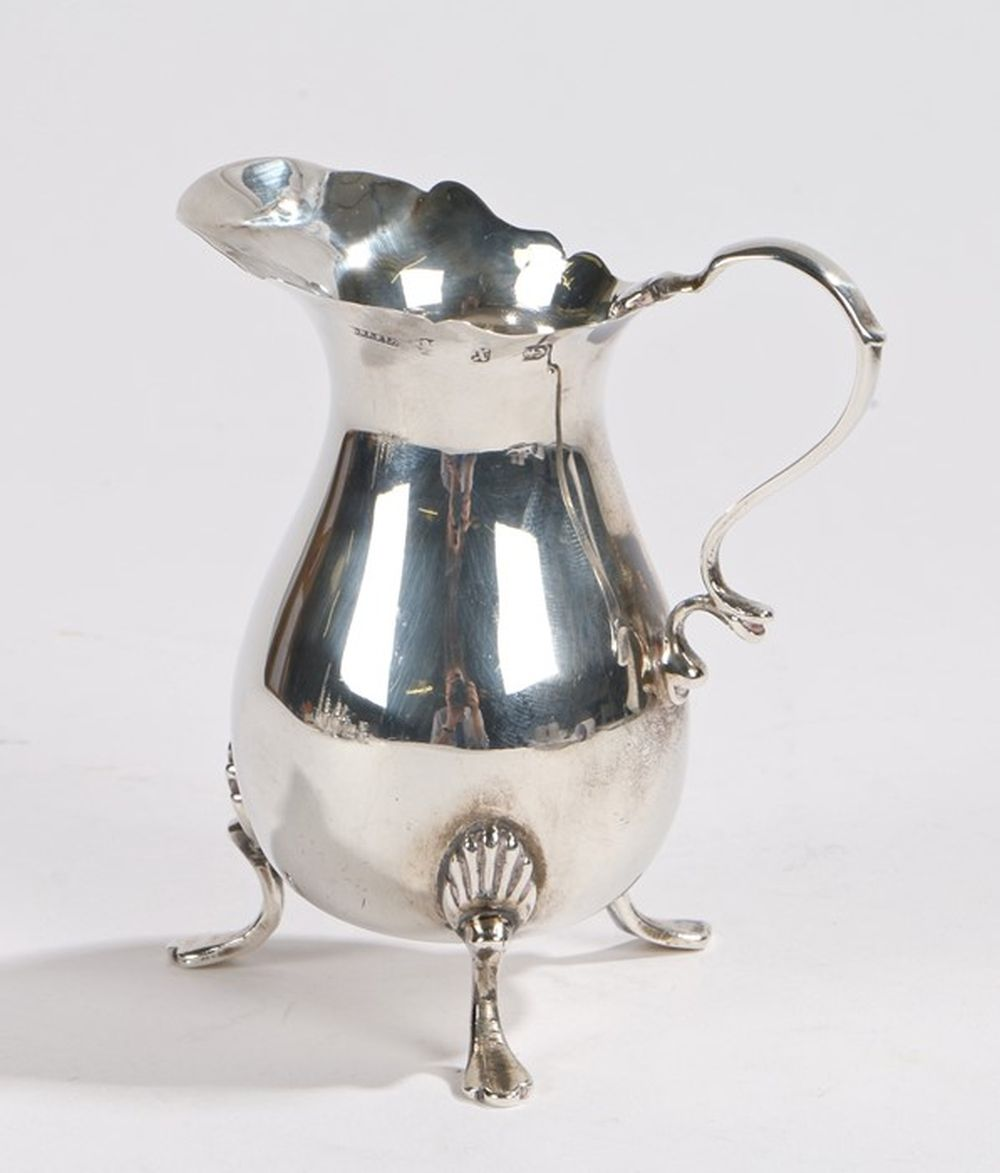 Victorian silver cream jug, Birmingham 1897, makers marks rubbed, with double scroll handle and wavy