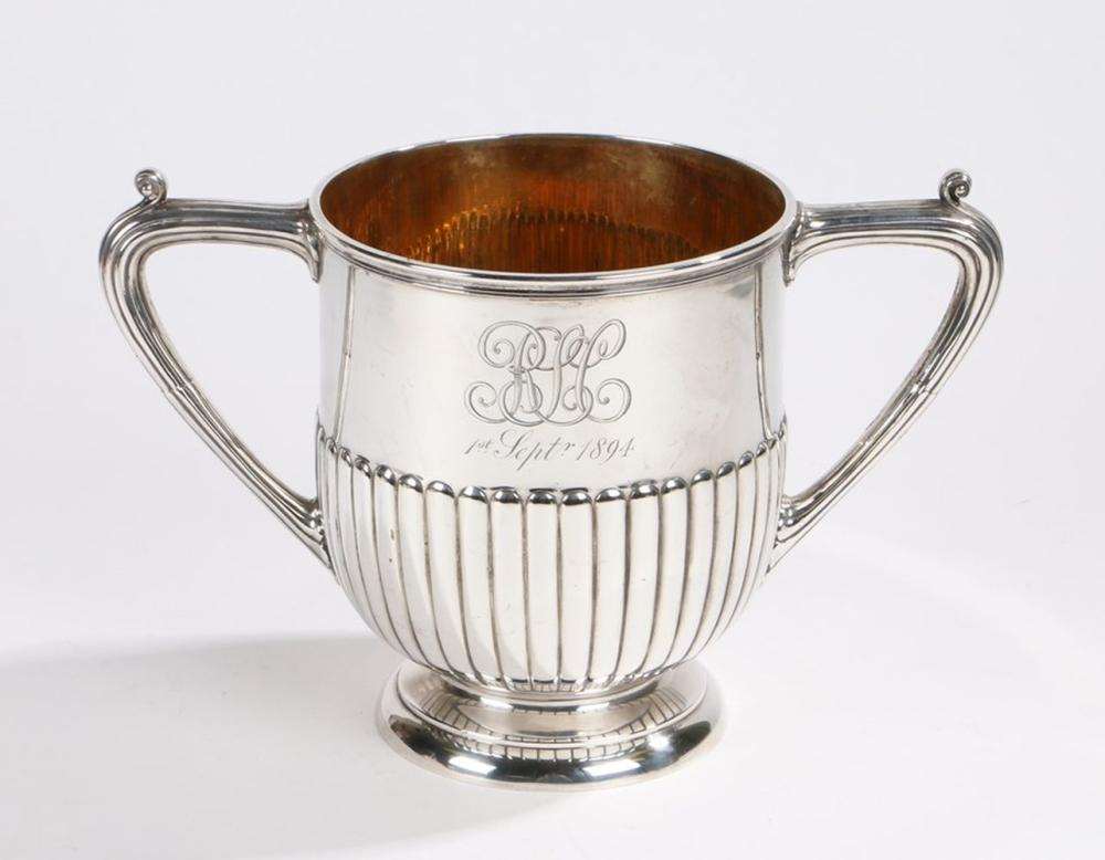 Victorian silver twin handled cup, London 1892, maker  Walter & John Barnard, with reeded scroll cap