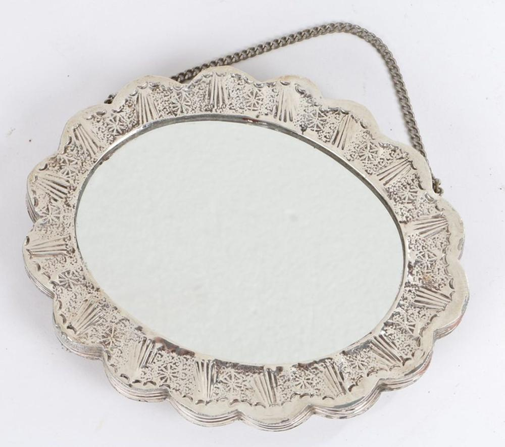 19th Century Turkish silver mirror, with foliate and scroll embossed back, oval mirror plate, on a w