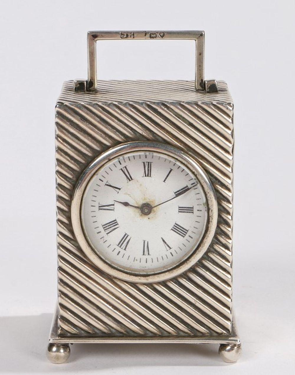 Victorian silver boudoir clock, London 1893, maker JB, with angular swing handle to the horizontal r