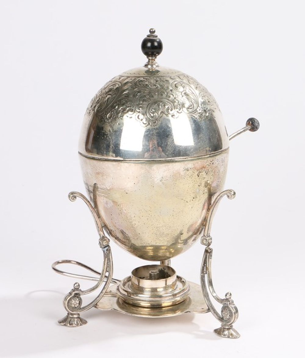 Edwardian egg cruet/warmer, of ovoid form, the cover with embossed foliate and scroll decoration, op