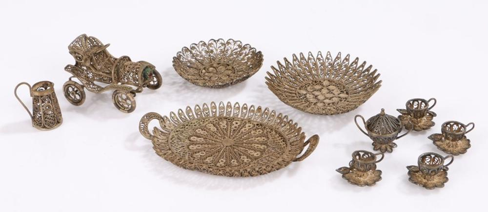 Silver filigree miniature tea service, consisting of oval twin handled tray, four teacups with attac