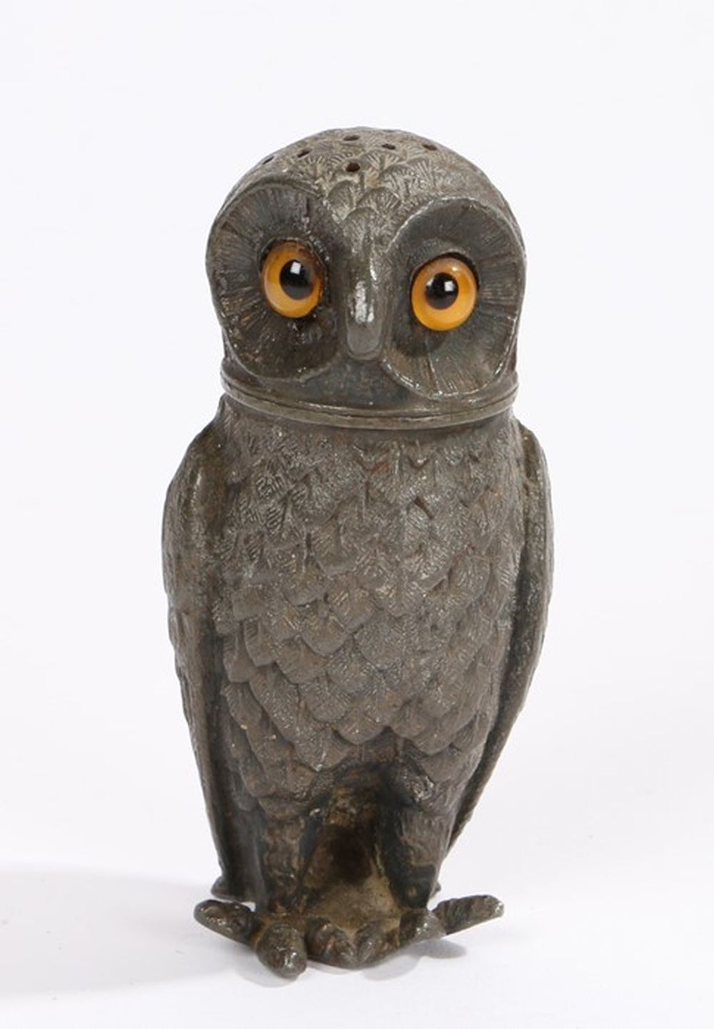 White metal pepperette in the form of an owl, with orange eyes to the removable cap, 8cm high