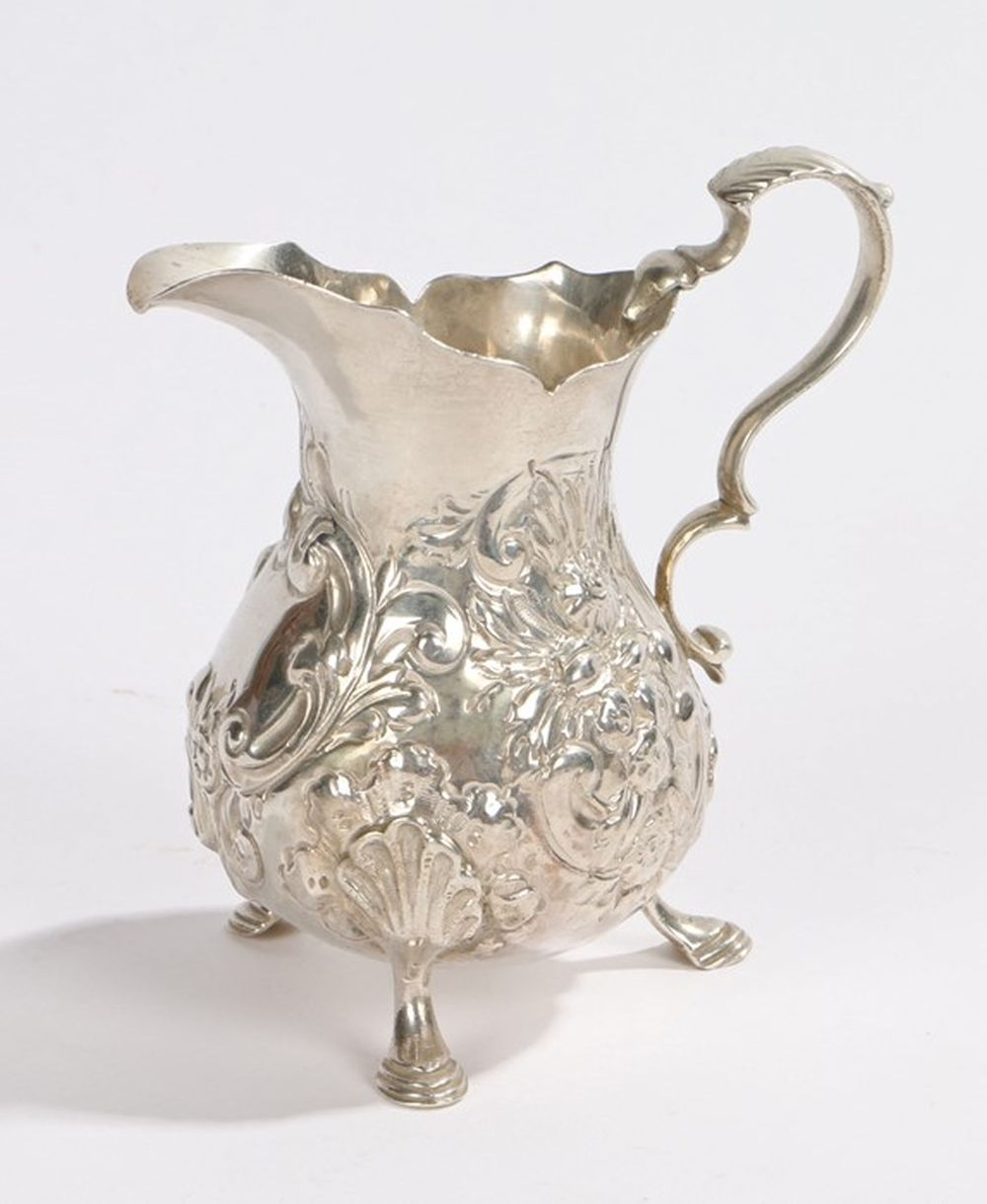 George III silver cream jug, London 1762, maker I.D, with acanthus leaf capped double scroll handle,