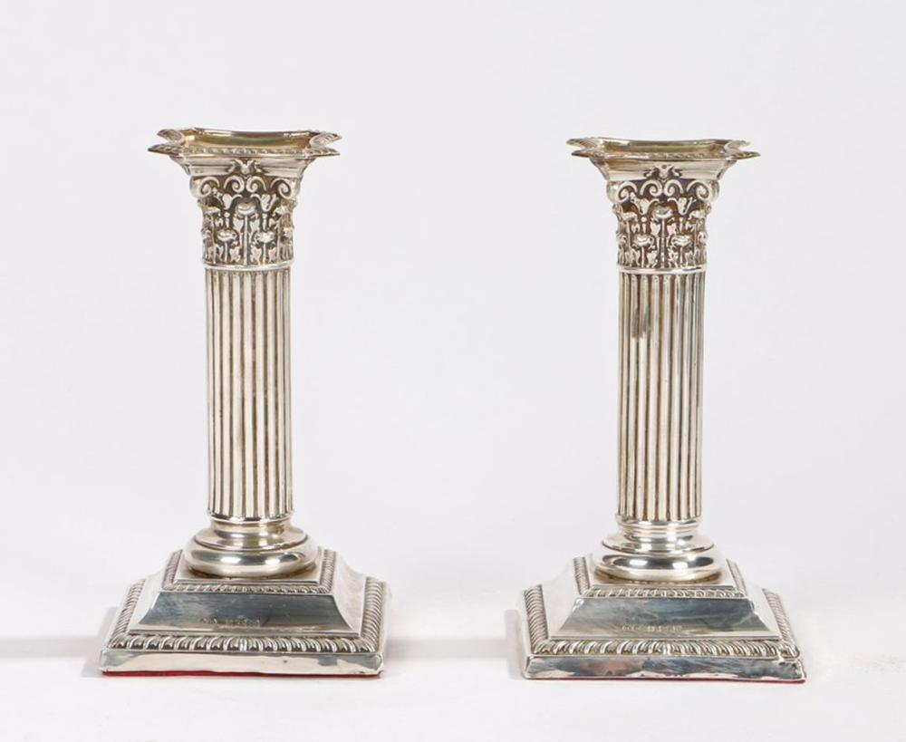 Pair of George V silver candlesticks, Birmingham 1911, maker Henry Matthews, of squat Corinthian col
