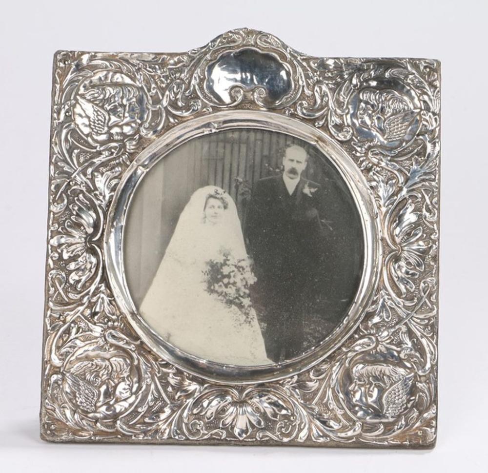 Victorian silver picture frame, Birmingham 1897, maker Henry Matthews, the cherub and foliate border