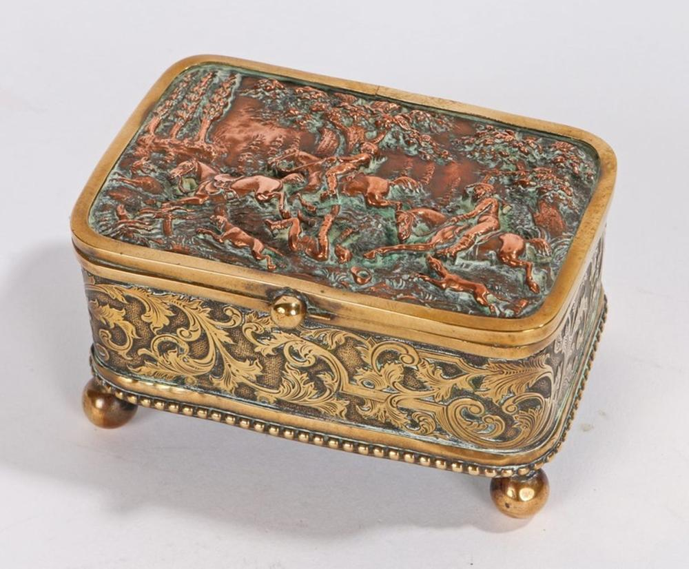 19th Century brass and copper jewellery casket, with a fox hunt scene to the lid and swag decoration