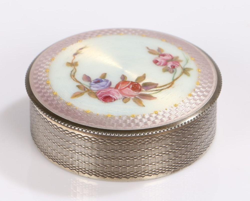 Swiss silver and enamel box and cover, of cylindrical form, the puce and white enamel lid with folia