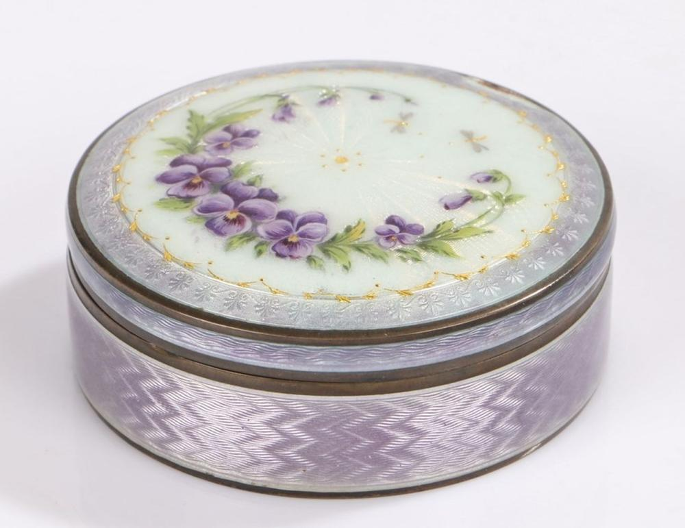 Continental silver and enamel box and cover, of cylindrical form, the purple, gilt and white enamel