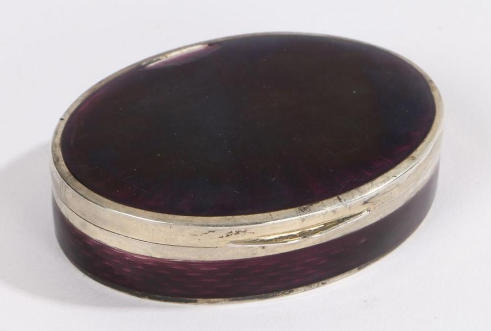 Continental silver and enamel box, of oval form with purple enamel engine turned lid and body, the g