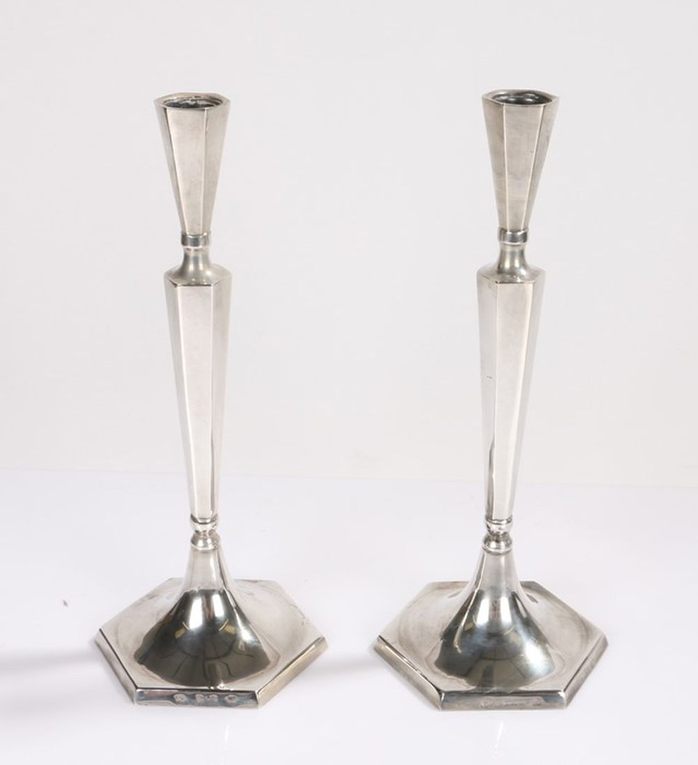 Pair of sterling silver candlesticks, the hexagonal tapering sconces and stems on domed hexagonal ba