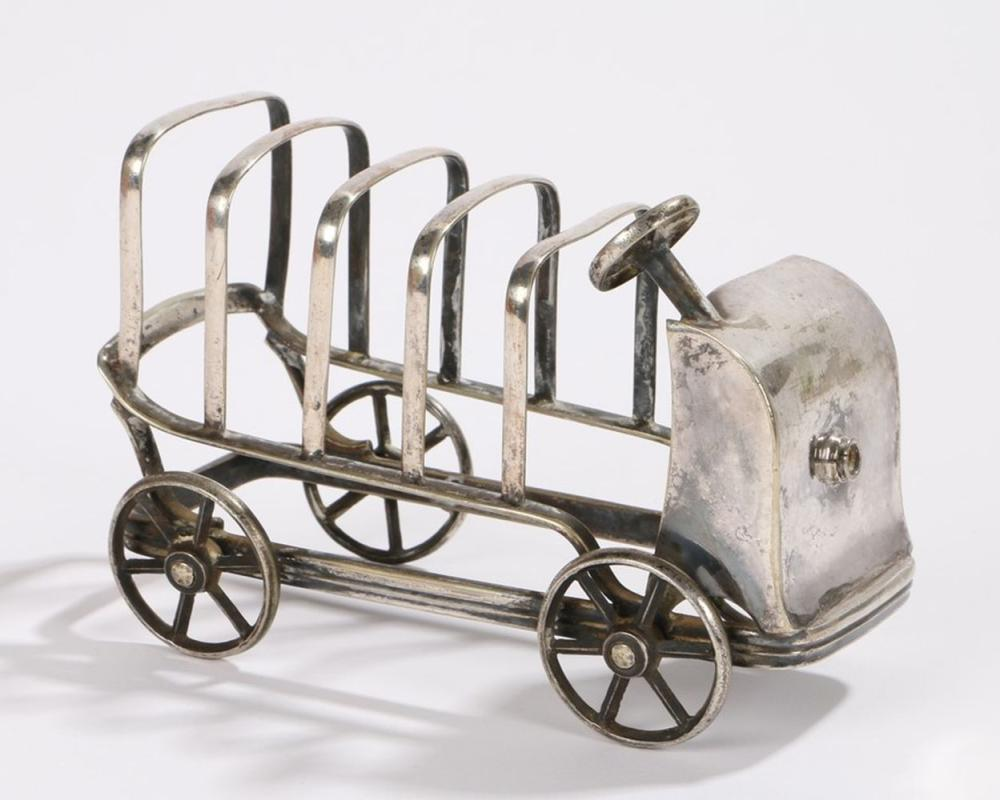 Edwardian novelty toast rack in the form of a car with four rotating wheels, 13cm wide